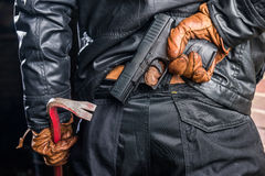 Midsection rear view of gangster holding crowbar while hiding pi Royalty Free Stock Images