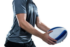 Midsection of rugby player in black jersey holding ball Stock Photo