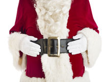 Midsection Of Santa Claus With Hands On Stomach. Standing against white background Royalty Free Stock Image
