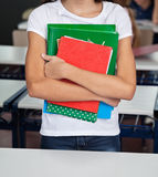 Midsection Of Schoolgirl Holding Books Royalty Free Stock Photography