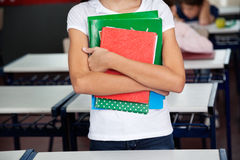 Midsection Of Schoolgirl Holding Books Royalty Free Stock Images