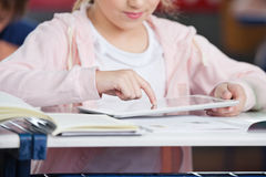 Midsection Of Schoolgirl Using Tablet At Desk Stock Images