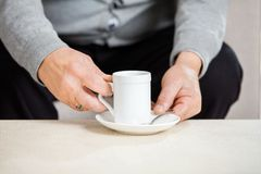 Midsection Of Senior Man Holding Coffee Cup Stock Images