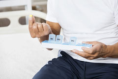 Midsection Of Senior Man Holding Pill And Container Royalty Free Stock Image