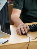Midsection Of Senior Student Using Desktop PC Royalty Free Stock Images
