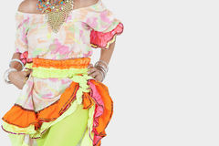 Midsection of senior woman in Brazilian costume over gray background Stock Images
