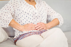 Midsection of senior woman suffering from stomach pain Royalty Free Stock Photography