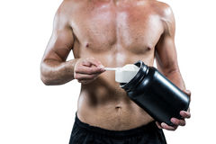 Midsection of shirtless man scooping up protein powder Stock Image