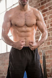 Midsection of shirtless man showing his body Royalty Free Stock Images