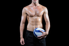 Midsection of shirtless sports player holding ball Royalty Free Stock Images