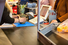 Midsection of shop assistant and customer Royalty Free Stock Images