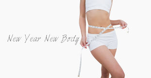 Midsection of slim woman measuring waist Royalty Free Stock Image