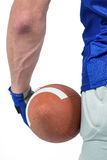 Midsection of sport person holding ball Royalty Free Stock Photography