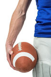 Midsection of sports player holding ball Royalty Free Stock Photo