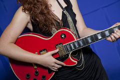 Midsection of teenage girl playing guitar Stock Photo