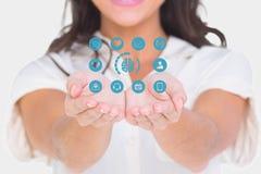 Midsection van vrouw met medische pictogrammen Stock Foto's