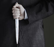 Midsection van Zakenman Holding Knife Stock Afbeelding