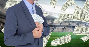 Midsection van zakenman verbergend geld in blazer bij voetbalstadion die corruptie vertegenwoordigen royalty-vrije stock afbeelding