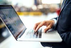 A midsection of industrial man engineer in a factory with laptop, typing. royalty free stock photo