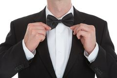 Midsection of waiter adjusting bowtie Stock Photography