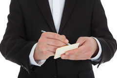 Midsection Of Waiter Writing On Notepad Stock Images