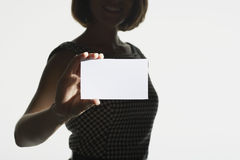 Midsection Of Woman With Blank Card Royalty Free Stock Images
