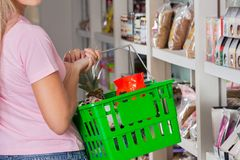 Midsection Of Woman Carrying Shopping Basket Royalty Free Stock Photo