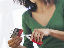 Midsection Of Woman Cutting Credit Card Royalty Free Stock Photos