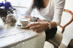 Midsection of woman having coffee at cafe Royalty Free Stock Image