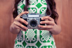 Midsection of woman holding camera Royalty Free Stock Photography