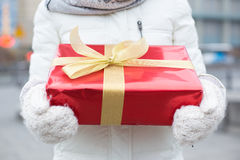 Midsection of woman holding gift box winter Stock Photography