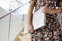 Midsection Of Woman With Laptop On Staircase  Royalty Free Stock Photo