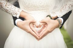 Midsection of Woman Making Heart Shape With Hands royalty free stock image