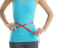 Midsection Of Woman Measuring Her Waistline Royalty Free Stock Image