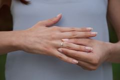 Breaking up the engagement. Midsection of a woman taking off the engagement ring after an argument stock images