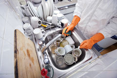 Midsection of woman washing utensil at kitchen sink Stock Photography