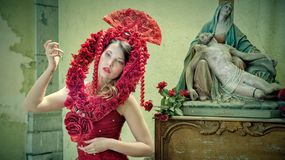 Midsection of Woman Wearing Red Flower Royalty Free Stock Images