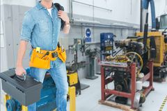 Midsection of worker working in workshop Stock Photos