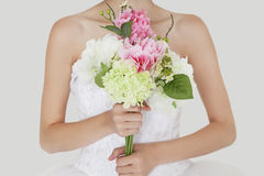 Midsection of young bride holding fresh bouquet Royalty Free Stock Photo