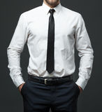 Midsection of young businessman in formal white shirt, black tie Royalty Free Stock Photography