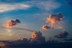 Midsized orange cumulus clouds Stock Photo