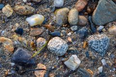 Midsized rocks, stones, and pebbles in various colors and shapes. Mid-sized rocks, stones, and pebbles in various colors and shapes royalty free stock photo