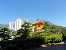 Midst the City Scape. A temple in a garden inside a big city Royalty Free Stock Photo