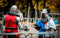 In the midst of a modern knight battle ... The Knights are ready for battle! They got their swords ... who will win ....? What can be more spectacular than a Royalty Free Stock Photography