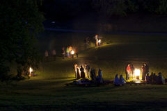 Midsumer or John's eve celebration in Latvia. People celebrate summer solstice night around a bonfires in Latvian village. Midsumer or John's eve celebration Royalty Free Stock Image