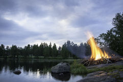 Midsummer bonfire in Finland. Traditional midsummer (summer solstice) bonfire in Savonlinna, Finland Royalty Free Stock Image