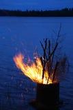 Midsummer bonfire at lakeside Royalty Free Stock Photo