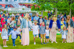 Midsummer celebration in Gothemburg, Sweden. GOTHENBURG, SWEDEN - JUNE 19, 2015: Cheerful people dancing around the maypole during Midsummer celebration in Royalty Free Stock Photos