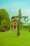 Midsummer cross in Tradgardsforeningen, the Garden. Society park, Gothenburg city downtown Royalty Free Stock Photos