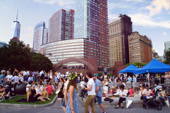 Midsummer evening weekend in the Battery park. New York, United States - June 20, 2015: People relax in the Robert F Wagner Junior Park in Midsummer evening in Royalty Free Stock Image